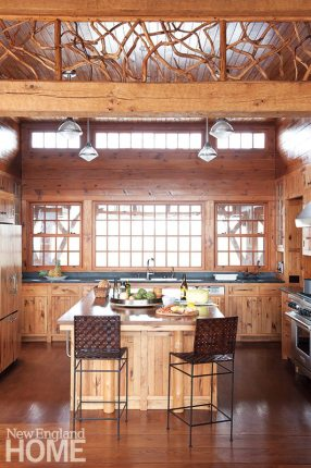 The kitchen is outfitted in butternut wood cabinetry and millwork.