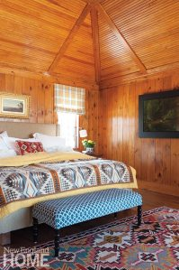 The master bedroom, like the rest of the house, wraps its inhabitants in a warm embrace.