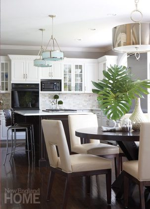 Dark-green granite counters gave way to white Calacatta marble in the kitchen. Glick swapped out a country pine table for the contemporary dark-wood table and surrounded it with streamlined chairs in white leather.