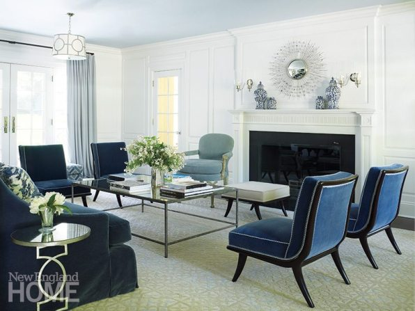 Designer Amy Aidinis Hirsch gave the living room a more spacious feel by adding the white paneling.