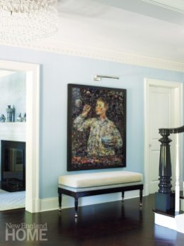 The homeowners' art collection includes this painting, by the Brazilian artist Vic Muniz, that hangs in the foyer.