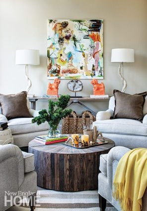 Designer Honey Collins opted for casual, but not outdoorsy, furnishings for the sun porch because the space is open to the living room.