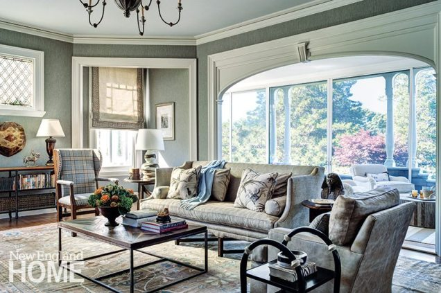 The living room's herringbone wallpaper lends a masculine touch, while a botanical rug adds a hint of femininity.