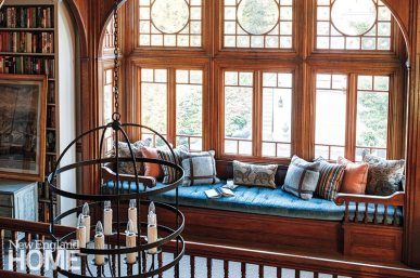 The second-floor landing doubles as a cozy spot for enjoying a good book.
