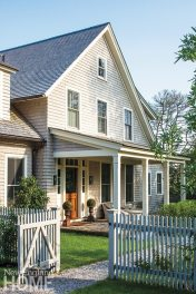 "A picket fence with climbing roses and a covered front porch provide the story-book look author Jane Green wanted for her ""new old house."""