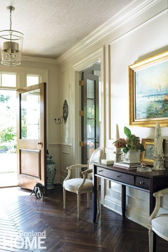 The front hall has high-gloss walls and a herringbone floor that was hand-rubbed piece by piece as it was installed to give it a patina.