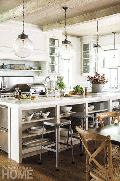 """The design of the kitchen island, with its open shelves, was """"directly copied from Martha Stewart's kitchen in Bedford,"""" says Green, who painted the cabinets in Stewart's Bedford Gray."""