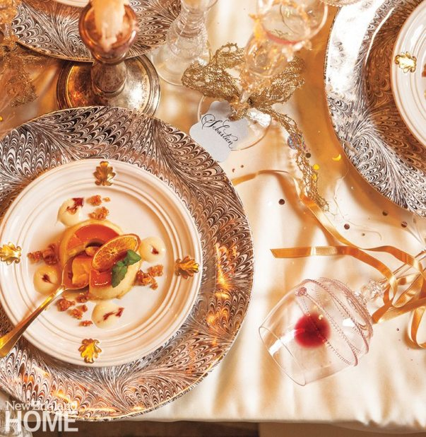 A Firenze charger, with its Florentine marbling in shimmering gold and platinum, makes a dramatic partner for the simpler Acanthus whitewash salad plate and the mouth-blown Amalia wineglass.