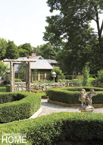 Formal gardens, tree groves, and meandering walkways surround the New Preston house.