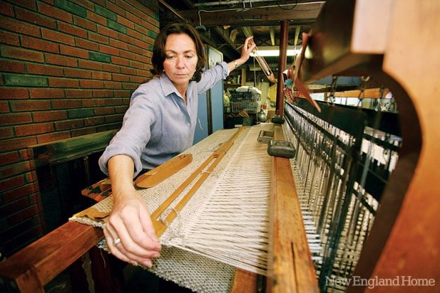 Karin Sheppard at her loom creating one of her fine throws.