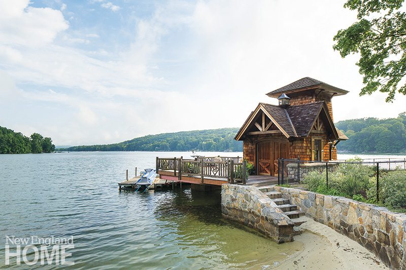 The charming boathouse and the stone retaining wall at the lake's edge were the starting point for the multistage construction project.