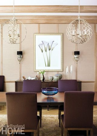 Texture reigns in the dining room, where grasscloth walls and chairs outfitted in plum-colored wool surround a table that can seat up to twenty.