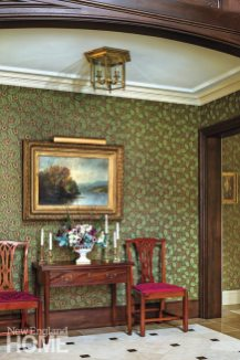 The William Morris-style wallpaper in the hall is by Bradbury & Bradbury. A circa-1875 landscape of the Adirondacks by J.A. Hekking hangs above an eighteenth-century Philadelphia games table.