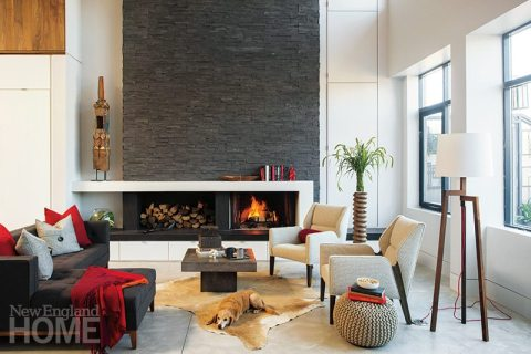 Vertical and horizontal elements form a pleasing composition, as in the tall wall of slate above a long, narrow fireplace mantel.