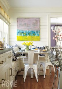 Metal chairs from Design Within Reach surround an intimate breakfast area in the kitchen.
