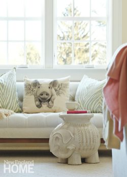 Quiet colors predominate in the master bedroom. The flying pig pillow was a gift from the homeowner's sister.
