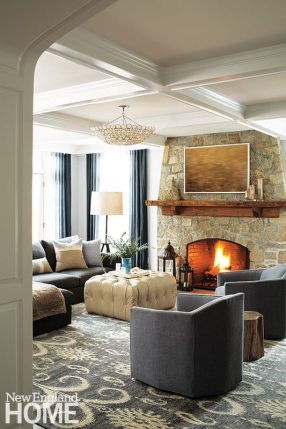 The ombré drapery panels inspired the choice of the deep silvery-gray furniture and rug for the family room.