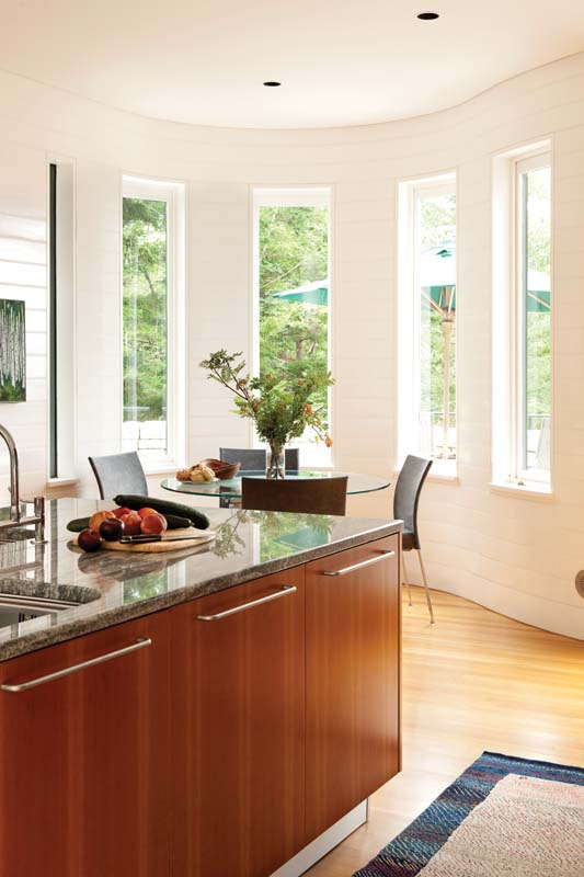 Most rooms, including the kitchen, connect to the outdoors via decks.