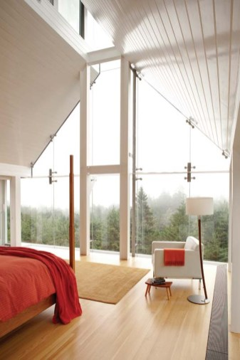 In the master bedroom, design and construction elements meld with the Maine woods in a dramatic, ever-changing composition.