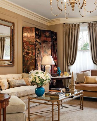 Elegant moldings give the living room lasting character. The iron and gilt chandelier is English made.