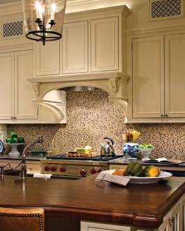 Architect-designed and meticulously executed cabinetry elevates the kitchen.
