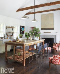 Antique beams give the kitchen a sense of continuity with the original house.