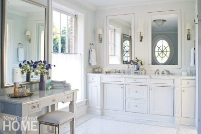 The master bath was refreshed by white and gray marble tiles, an enlarged shower, and a new vanity.