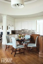 A soffit helps delineate the cooking area in the open kitchen, while the curved counter creates a nook for the breakfast area.