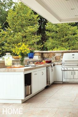 An Indian granite counter frames the outdoor kitchen.
