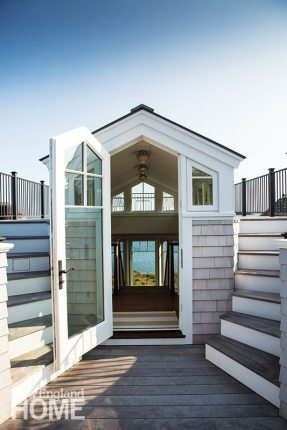 Steps lead from a studio to an exterior deck and the divided stairs that climb to the rooftop sitting area.