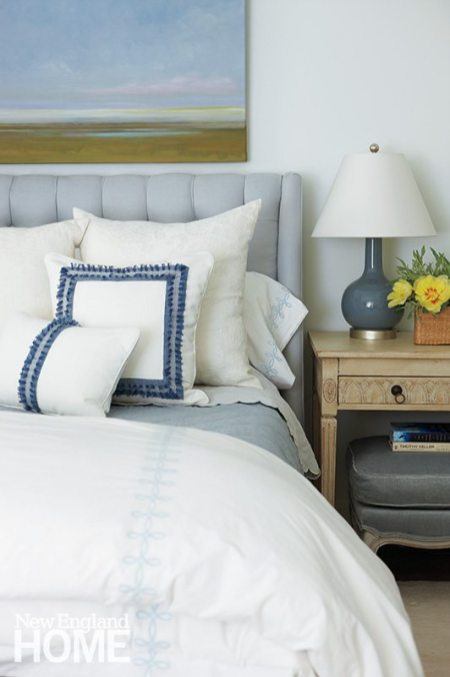The peaceful master bedroom sports the homeowners' favorite hues.