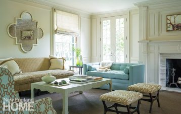 A living room seating area employs quiet hues jazzed up with texture and pattern.