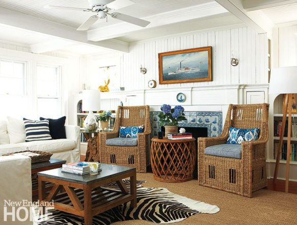 Wicker, rattan, and sisal are summerhouse staples in this Martha's Vineyard vacation home that overlooks the water. Designer Parker Rogers softened the formal architectural touches by adding fun touches like a zebra-print rug.