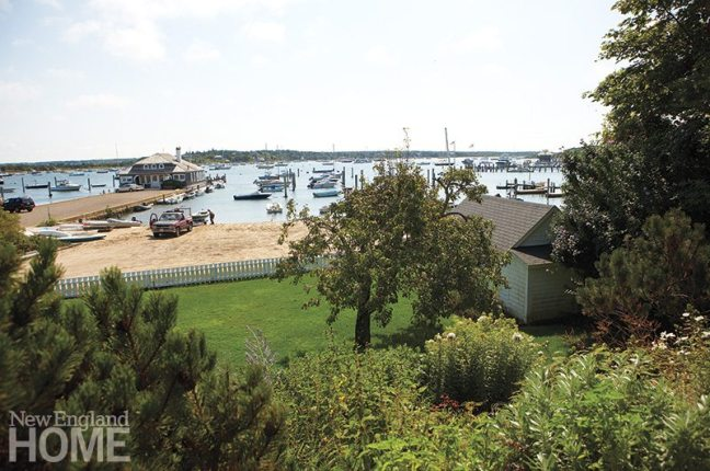 The sloping lawn leads to the active harbor.
