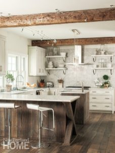 """An eye-catching """"X"""" brings visual interest to the kitchen peninsula. Contemporary stools make an arresting juxtaposition with the old wood."""