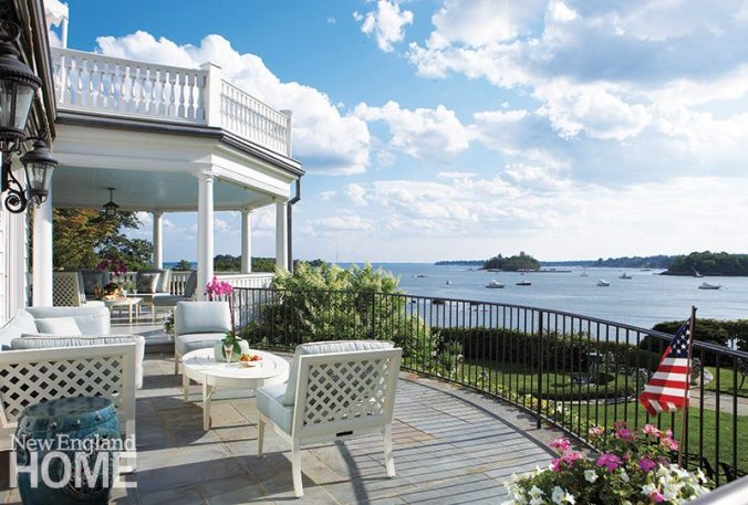 A deck above the porch doubles the stunning views.