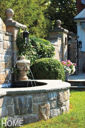 The water feature sits just off the kitchen terrace. Iron accents, stone steps and walls, and statuary add to the park-like appeal.