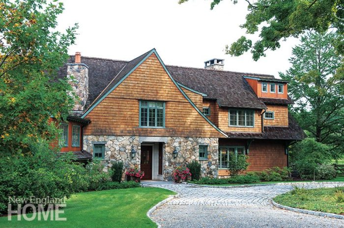 The stone-and-shingle Arts and Crafts-style residence holds a medley of historical references, along with quirky details that make it seem like a century-old home rather than a contemporary spec house.