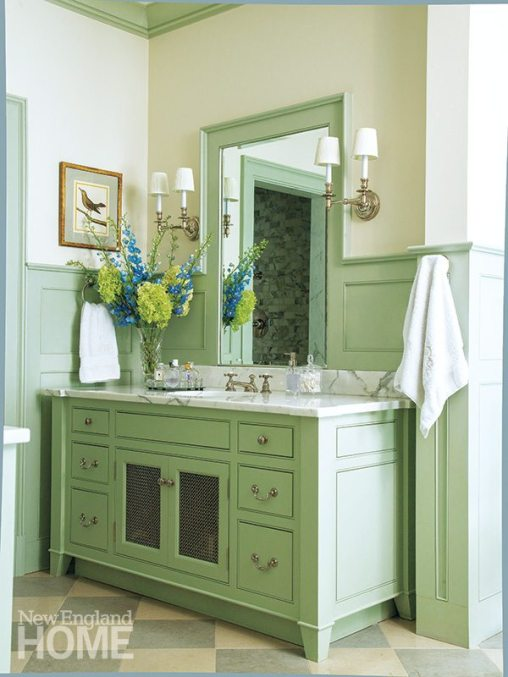 A marble-topped vanity, one of two in the master bath, is designed to look like a piece of furniture.