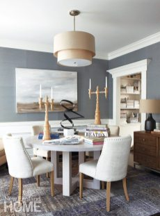 A custom table by D2 Interieurs holds sculptural pieces in the dining room, which Kerri sometimes uses for client meetings.