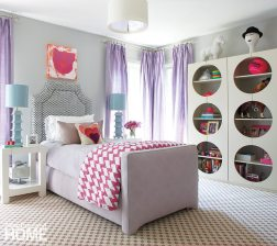 A Pottery Barn Teen cupboard with cutouts, lavender drapery fabric from Duralee, and a John Robshaw quilt give eleven-year-old Emma's room an edge.