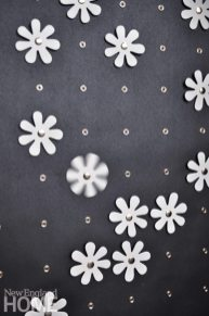 Scatta wallcoverings are easily altered by snapping on a series of separate accessories, like wooden daisies or fabric pompons.