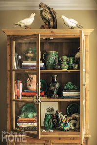 Taxidermied birds perch atop Belgian cupboards filled with treasures, including Joanna's collection of Palissy majolica.