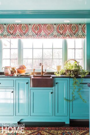 High-gloss turquoise cabinets and ceilings lend the butler's pantry a jewel-box vibe, while copper sinks and hardware provide a lovely contrast.