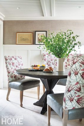 Adjacent to the kitchen, the breakfast room also sports a limestone floor.