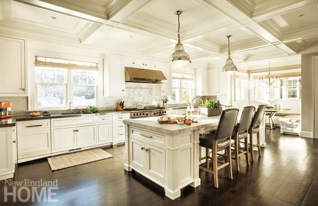 Contemporary hardware and materials update the classic white kitchen.