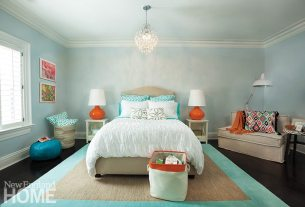 A daughter's bedroom is colorful, yet serene, and a sofa bed chair creates an additional lounging area.