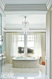 Sheers separate the master bath's mosaic standing tub from the views of Greenwich cove and Long Island Sound.