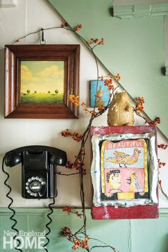 The landscape mounted above the old-fashioned phone was also painted by Daniel Tousignant.