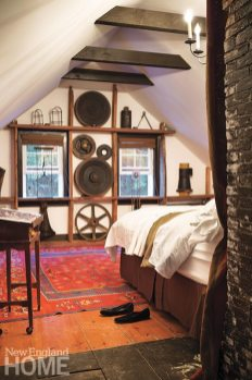 Rustic wheel forms make an engaging composition in the master bedroom.